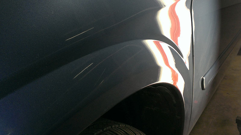 dented truck after repair